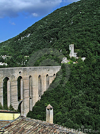 Medieval bridge and castle ruins on mountain side