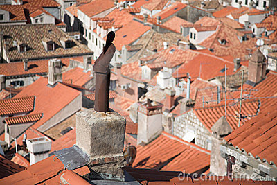 Medieval city view, rooftops and chimneys, tiles