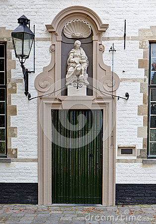 Medieval door and Holy Virgin in the beguinage of Bruges / Brugge, Belgium