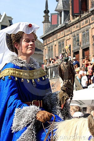 Medieval dressed lady with falcon Editorial Stock Image