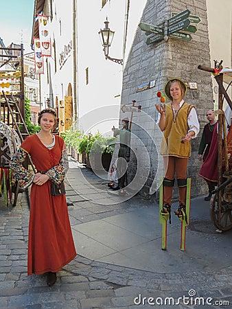 Medieval girl and jocker Editorial Image