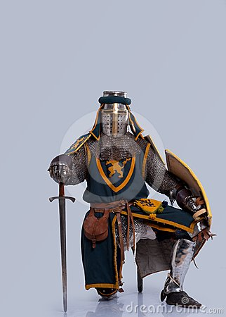 Medieval knight in full armor isolated on grey