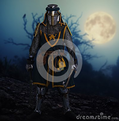 Medieval knight in full armor outdoors at night