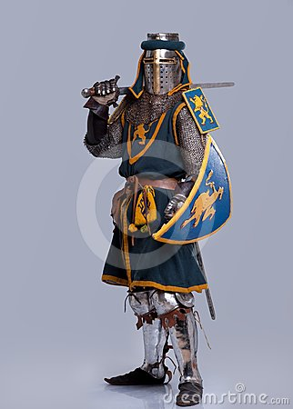 Medieval knight in full armor standing