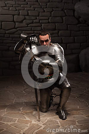 Free Medieval Knight Kneeling With Sword Royalty Free Stock Photography - 42214277