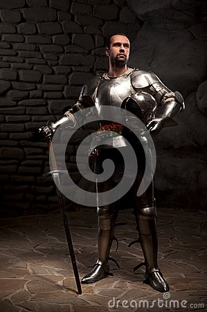 Free Medieval Knight Posing With Sword In A Dark Stone Stock Photos - 42214253