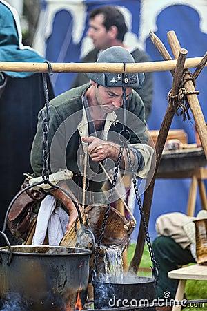 Medieval Man Preparing Food Editorial Stock Image