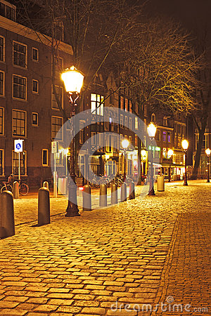 Medieval street in Amsterdam Netherlands by night