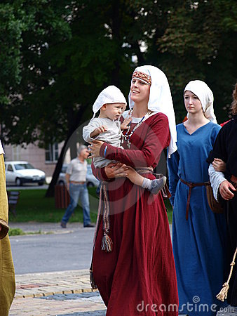 Medieval woman with a baby, Lublin, Poland Editorial Image