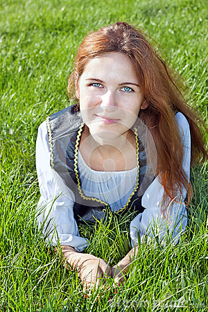 Medieval woman on the grass