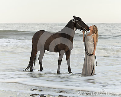 Medieval Woman And Horse In Water Stock Images - Image: 28146314