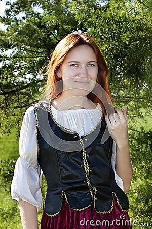 Medieval woman near the fir