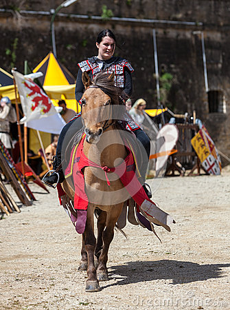Medieval Woman Riding a Horse Editorial Stock Image