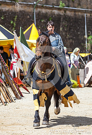 Medieval Woman Riding a Horse Editorial Stock Photo