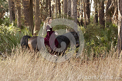 Medieval woman riding horse