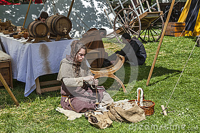 Medieval Young Woman Spinning Wool Editorial Stock Photo