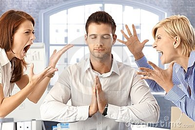 Meditating businessman with arguing colleagues