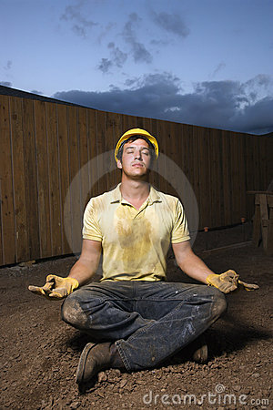 Meditating Construction Worker
