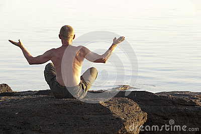 The meditating man on the seashore