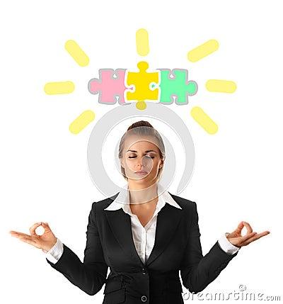 Meditating modern business woman