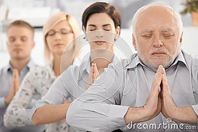 Meditating team portrait