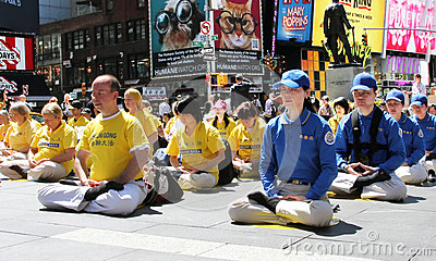 Meditating in Times Square Editorial Image