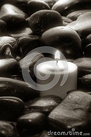 Meditation Candle Burning on Old Black Stones Path