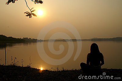 Meditation on Sunset at a lake