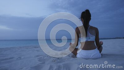 meditation  yoga woman meditating at serene beach in