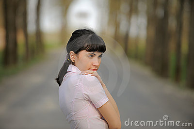 Meditative girl standing on a road