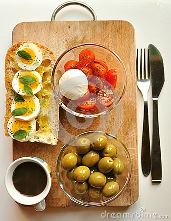 Mediterranean breakfast with coffee and sandwich