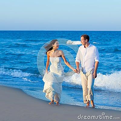 Mediterranean couple walking in blue beach