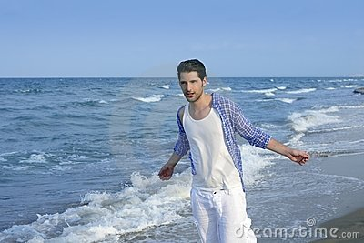 Mediterranean latin young man on beach