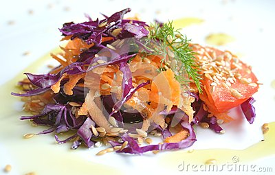 Mediterranean salad with cabbage , carrots and tomato