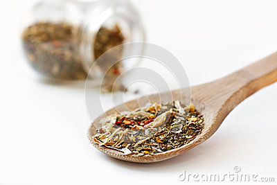 Mediterranean salad spices in oak spoon
