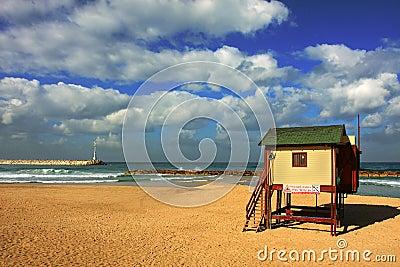 Mediterranean Sea beach under the cloudy sky.