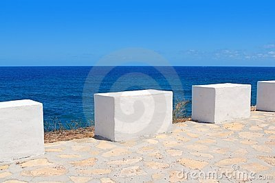 Mediterranean sea coastal view white milestones