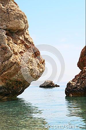 Mediterranean sea and tall cliffs.