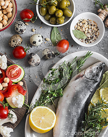 Free Mediterranean Style Food. Fish, Vegetables, Herbs, Chickpeas, Olives, Cheese On Grey Background, Top View. Healthy Food Concept. Royalty Free Stock Image - 89880126