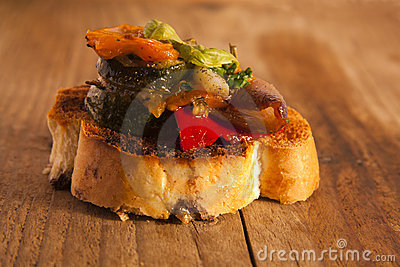 Mediterranean vegetable and bread snack.