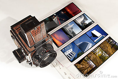 Medium format photo camera and diapositives.