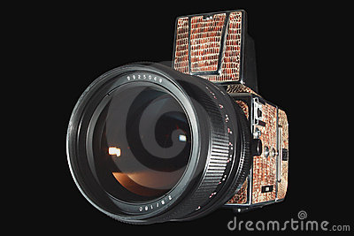 Medium format photo camera isolated on black.