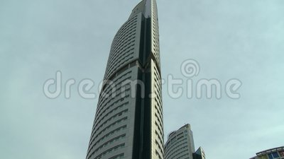 City Road And Towers, KL, Malaysia. Medium low-angle tilting shot of Kuala Lumpur City road with vehicles, flyover walking structures, and Petronas Tower 3, KL stock footage