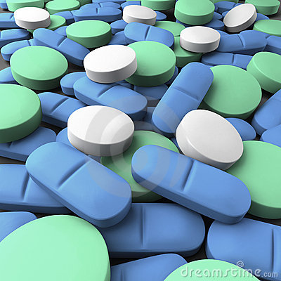 Medium shot of many green, blue and white tablets