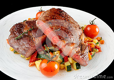 Medium well fried steak with vegetables