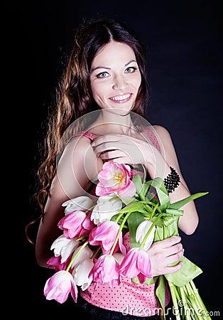 Meisje met tulpenbloemen