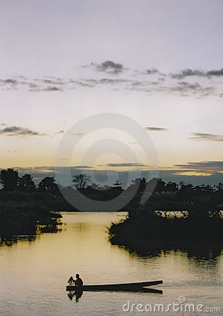 Mekong river twilight fishing boat laos