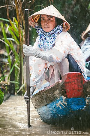 Free MEKONG, VIETNAM. Woman With Her Boat Carrying Tourists Royalty Free Stock Photo - 126778685