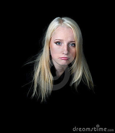 The melancholy girl on a black background.
