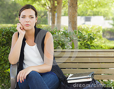 Melancholy Young Adult Woman Sitting on Bench Next